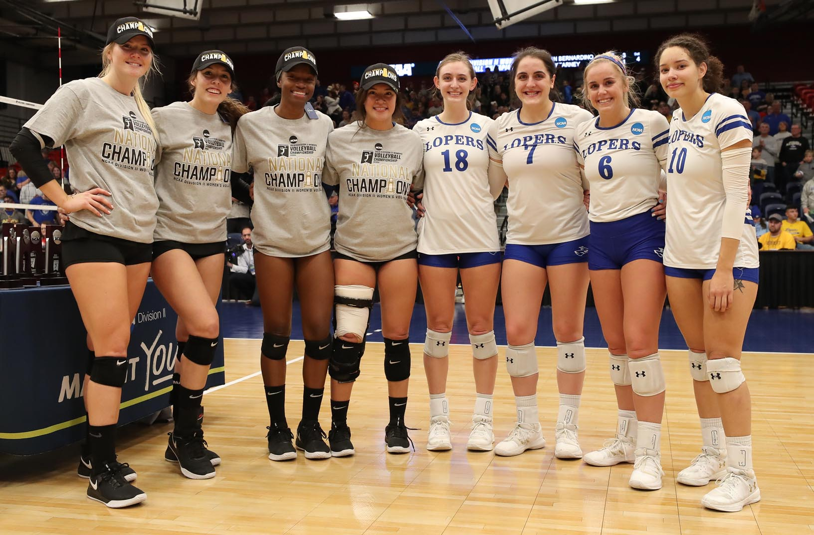 Joined by players from Cal State San Bernardino, UNK's Mary Katherine Wolfe (18), Anna Squiers (7), Maddie Squiers (6) and Julianne Jackson (10) are recognized as all-tournament selections Saturday following the NCAA Division II championship match at the Auraria Event Center in Denver.