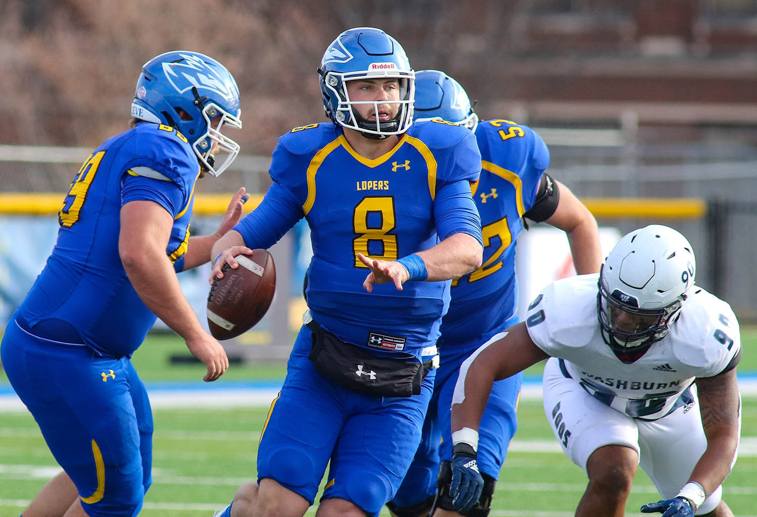 """Redshirt senior quarterback Alex McGinnis (8) has racked up nearly 2,800 total yards and 25 touchdowns during his UNK career, but the Lopers' appearance in Saturday's Mineral Water Bowl trumps any individual accomplishments. """"I didn't come here for personal accolades,"""" McGinnis said. """"I came here to be part of a bowl game. To see that come to fruition has been a pretty surreal experience."""" (UNK Communications)"""