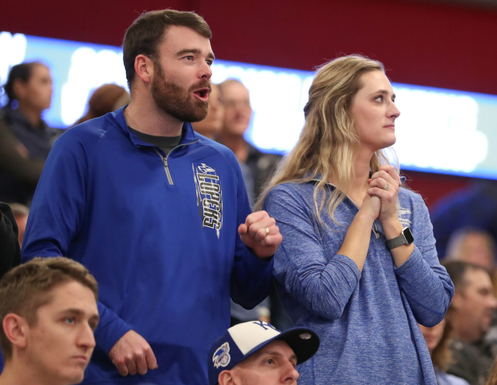 "Annie (Wolfe) Dineen and her husband, Kevin, support the UNK volleyball team at Saturday's NCAA Division II national championship in Denver. ""It's just so cool to hear Lopers and the word national championship mentioned at the same time. I'm just really proud to say I'm a former UNK player,"" said Wolfe. (Photo by Corbey R. Dorsey, UNK Communications)"