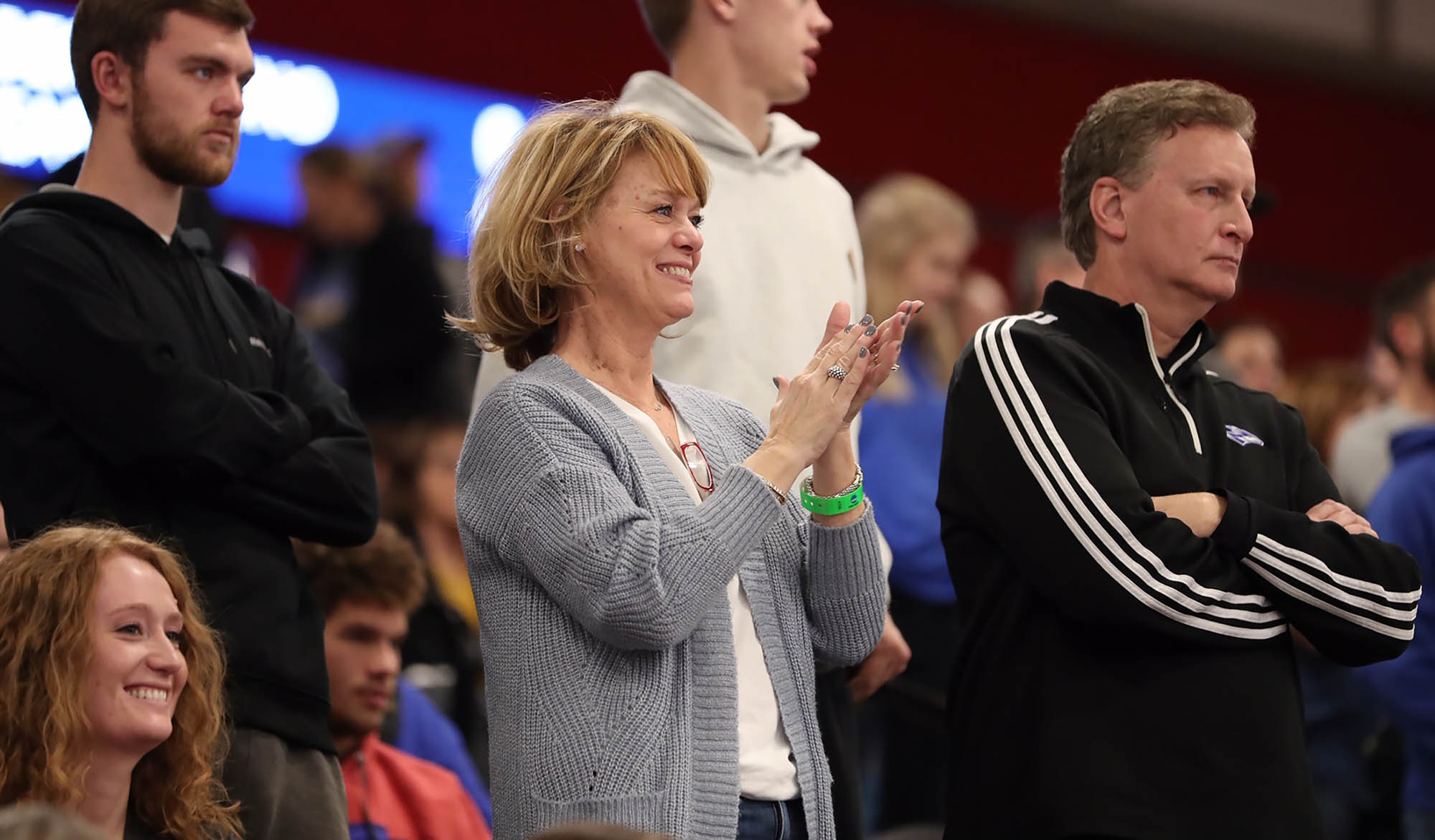 "Cindy Wolfe of Omaha, the mother of junior outside hitter Mary Katherine Wolfe, cheers on the Lopers during Saturday's NCAA Division II women's volleyball championship at the Auraria Event Center in Denver. ""I don't know how to describe it,"" Cindy Wolfe said of the experience. ""In the back of your mind you knew they could do it, but to actually be here is another thing. There are really no words, but I'm so excited for them."" (Photos by Corbey R. Dorsey, UNK Communications)"