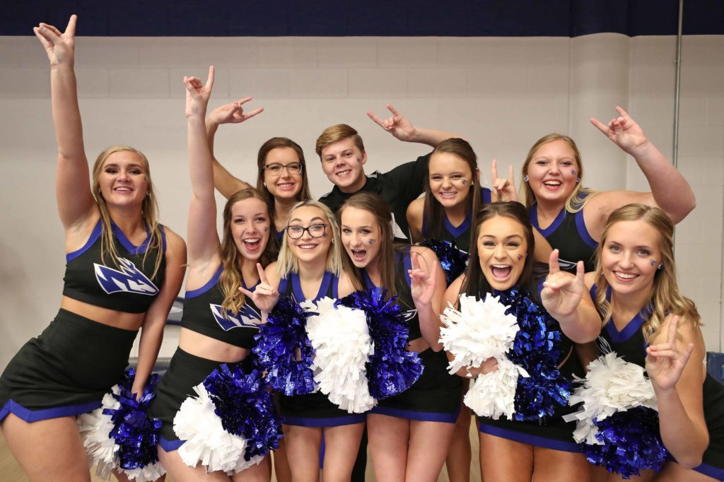 "The UNK cheer squad supported the Lopers Saturday during the NCAA Division II women's volleyball championship at the Auraria Event Center in Denver. Fayth Jackson, front row, second from right, called the experience ""one of the best things I've ever gotten to do."" (Photo by Corbey R. Dorsey, UNK Communications)"