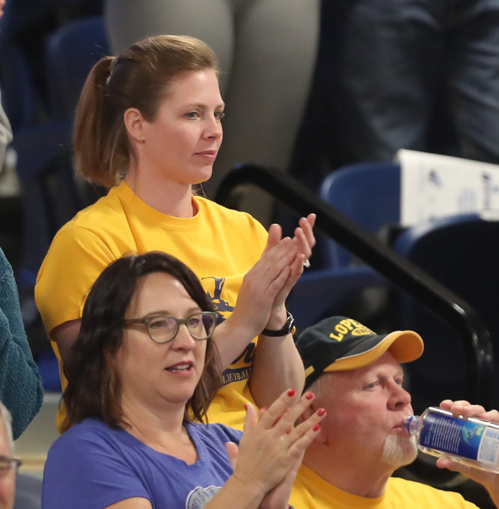 Former UNK volleyball player Erin (Arnold) Kay and her dad, Bill, cheer on the Lopers at Saturday's NCAA Division II national championship in Denver. (Photo by Corbey R. Dorsey, UNK Communications)