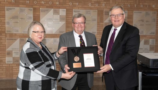 Tom Henning of Kearney, middle, receives the NU Presidential Medal of Service from UNK Chancellor Doug Kristensen and University of Nebraska Interim President Susan Fritz.