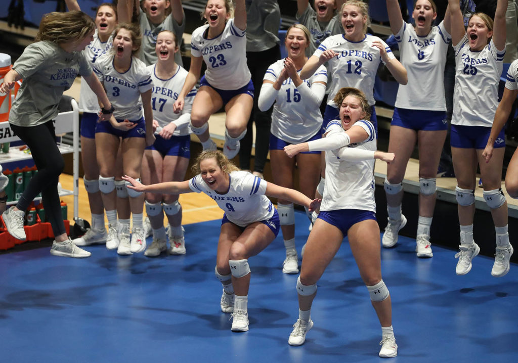 Emma Benton, front left, and Gracie Stienike lead the celebration during a UNK volleyball match. (Photo by Corbey R. Dorsey, UNK Communications)