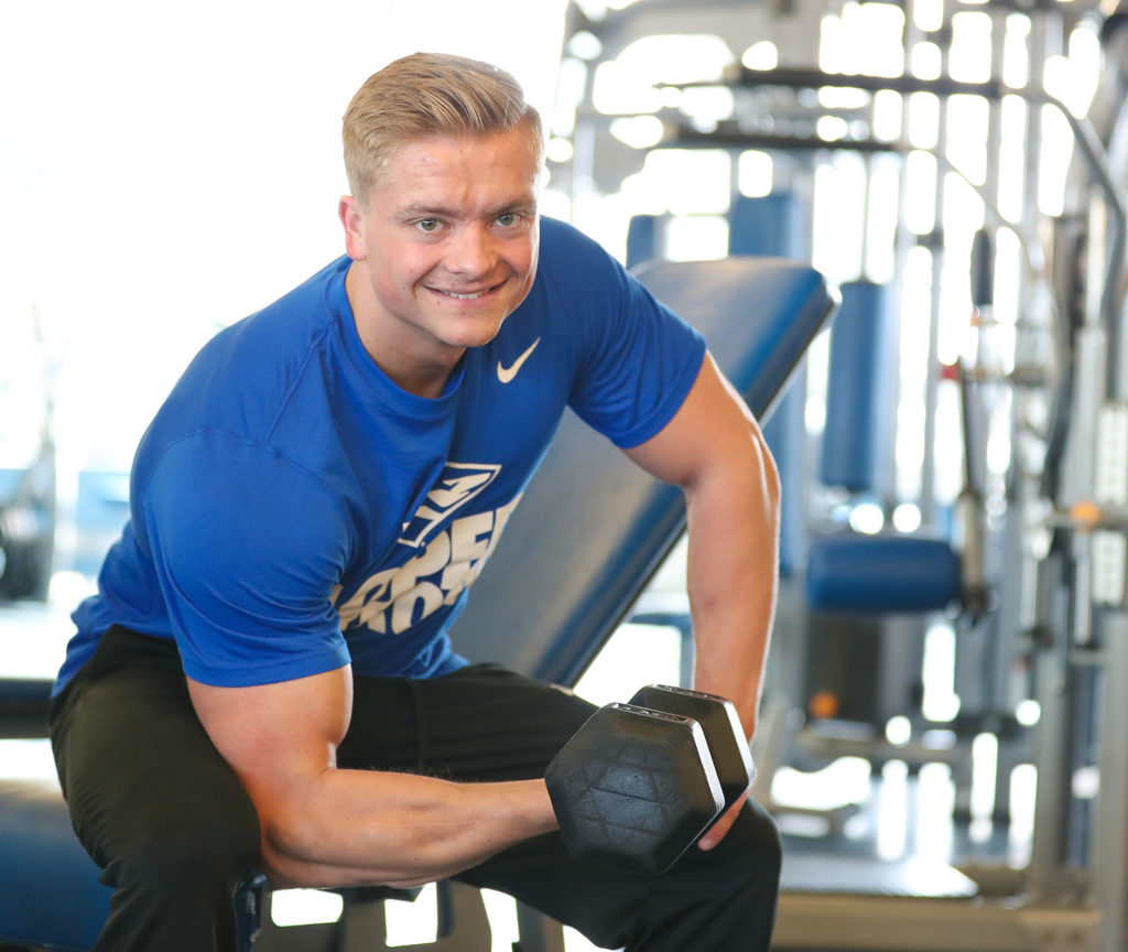 Michael Clark, a senior studying exercise science at UNK, hopes to turn his passion for physical fitness into a career as a strength and conditioning coach for a Division I collegiate football team.