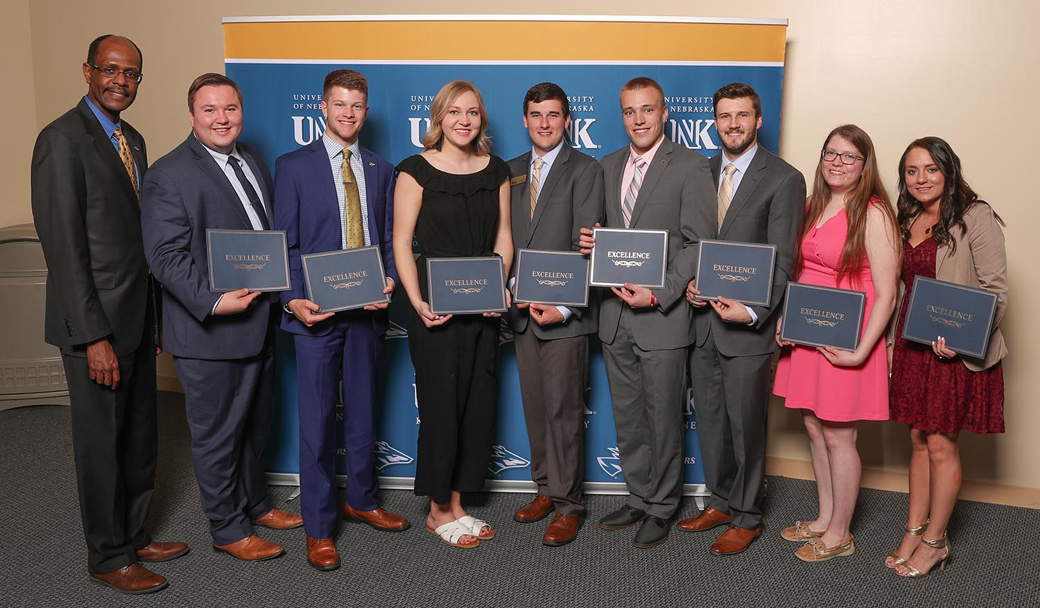 Ryan Clark, fourth from right, was one of nine UNK students who received the Mary Jane and William R. Nester Student Leadership Award in April. The award recognizes outstanding seniors who have excelled academically and demonstrated service, character and leadership during their time at UNK. (Photo by Corbey R. Dorsey, UNK Communications)