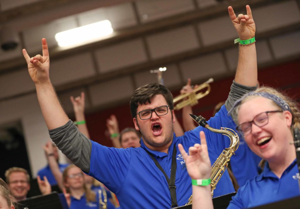 UNK pep band members Zac Dibbern of Brighton, Colorado, and Anna Overbeck of Omaha get fired up before Saturday's NCAA Division II women's volleyball championship at the Auraria Event Center in Denver. Twenty-four members of the UNK pep band made the 11-hour roundtrip to support the Lopers. (Photo by Corbey R. Dorsey, UNK Communications)
