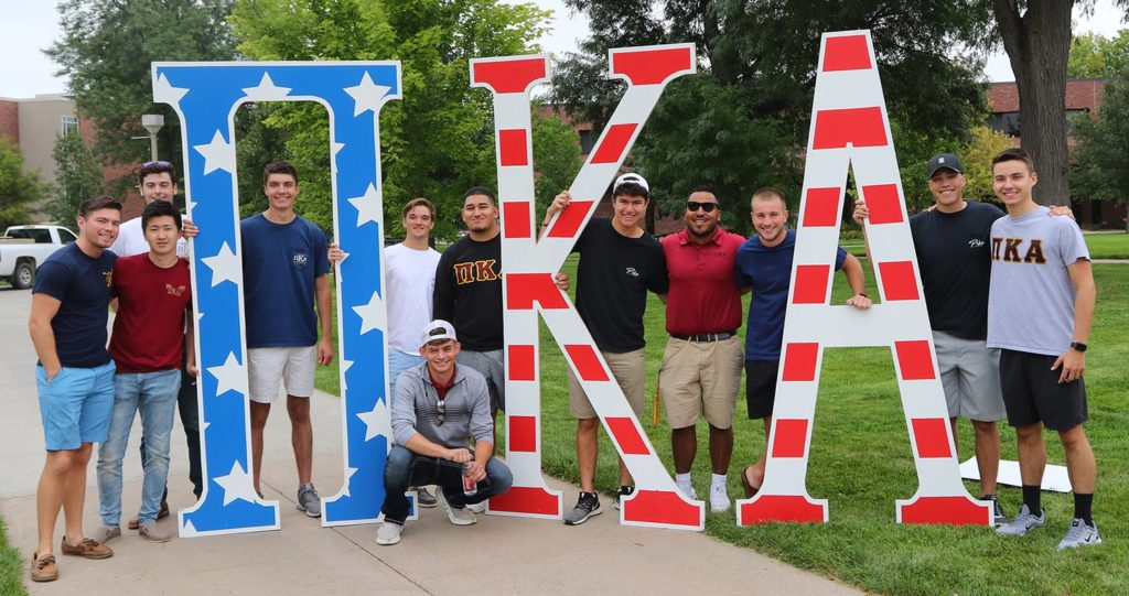 Ryan Clark, second from right, joined Pi Kappa Alpha as a sophomore at UNK. He's served as the fraternity's treasurer and president. (Photo by Todd Gottula, UNK Communications)
