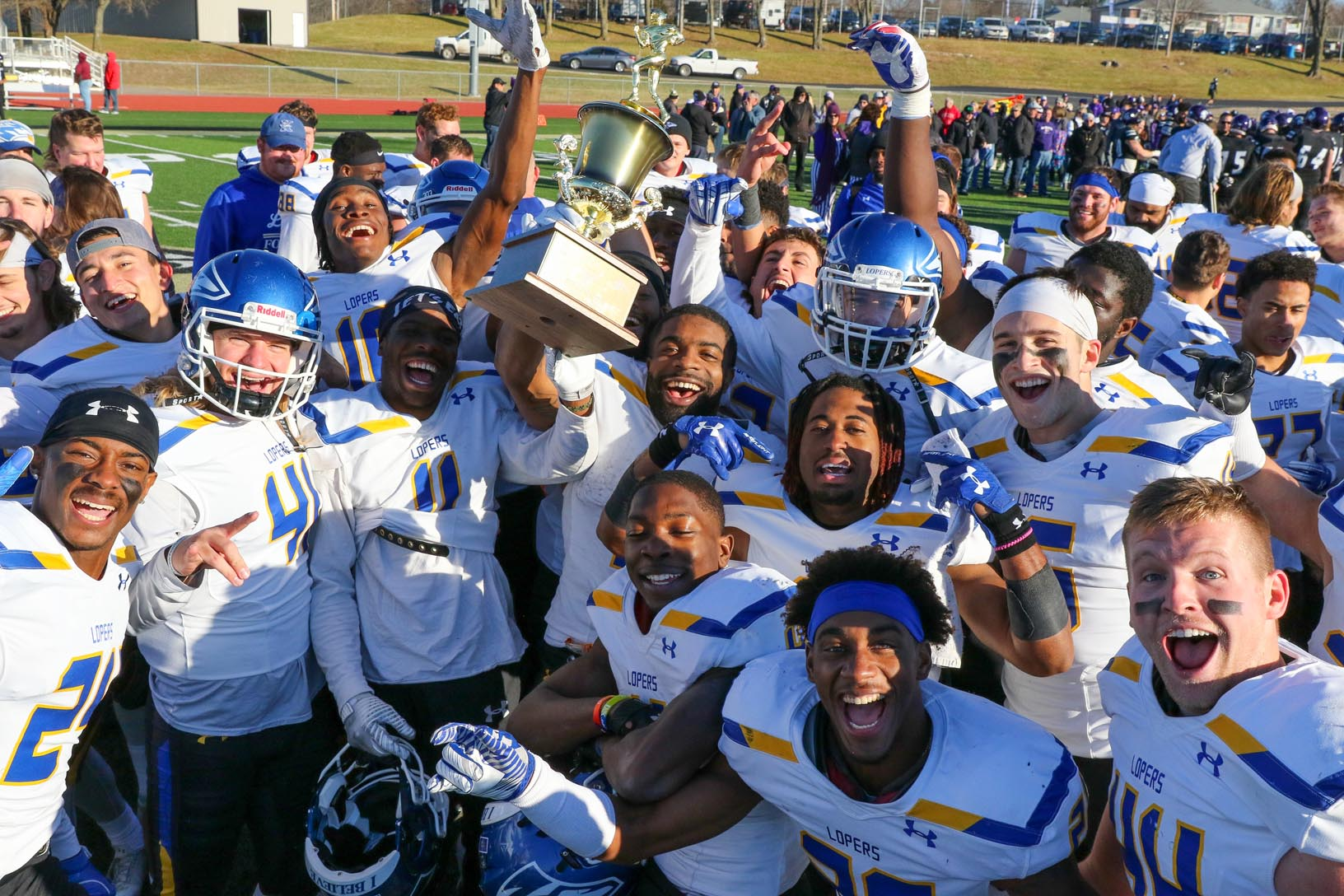 University of Nebraska at Kearney players celebrate their 50-33 win over Winona State in Saturday's Mineral Water Bowl in Excelsior Springs, Missouri. The Lopers finished the season 7-5 with the win. (Photo by Todd Gottula, UNK Communications)