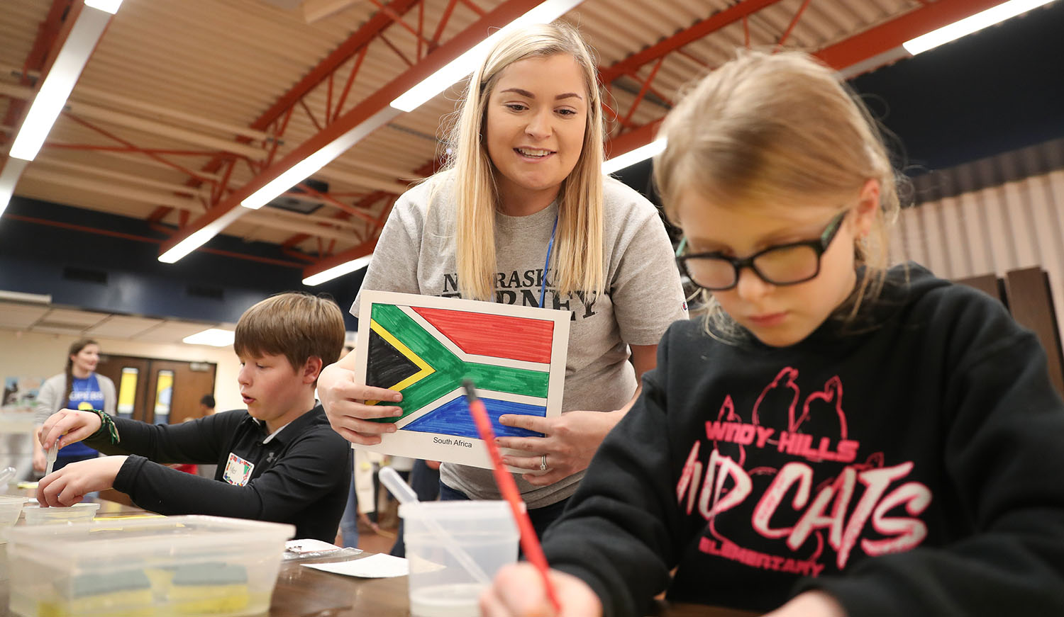 UNK student Samantha Svoboda, middle, leads an activity Friday during the Measurement Olympics at Windy Hills Elementary School in Kearney. (Photos by Corbey R. Dorsey, UNK Communications)