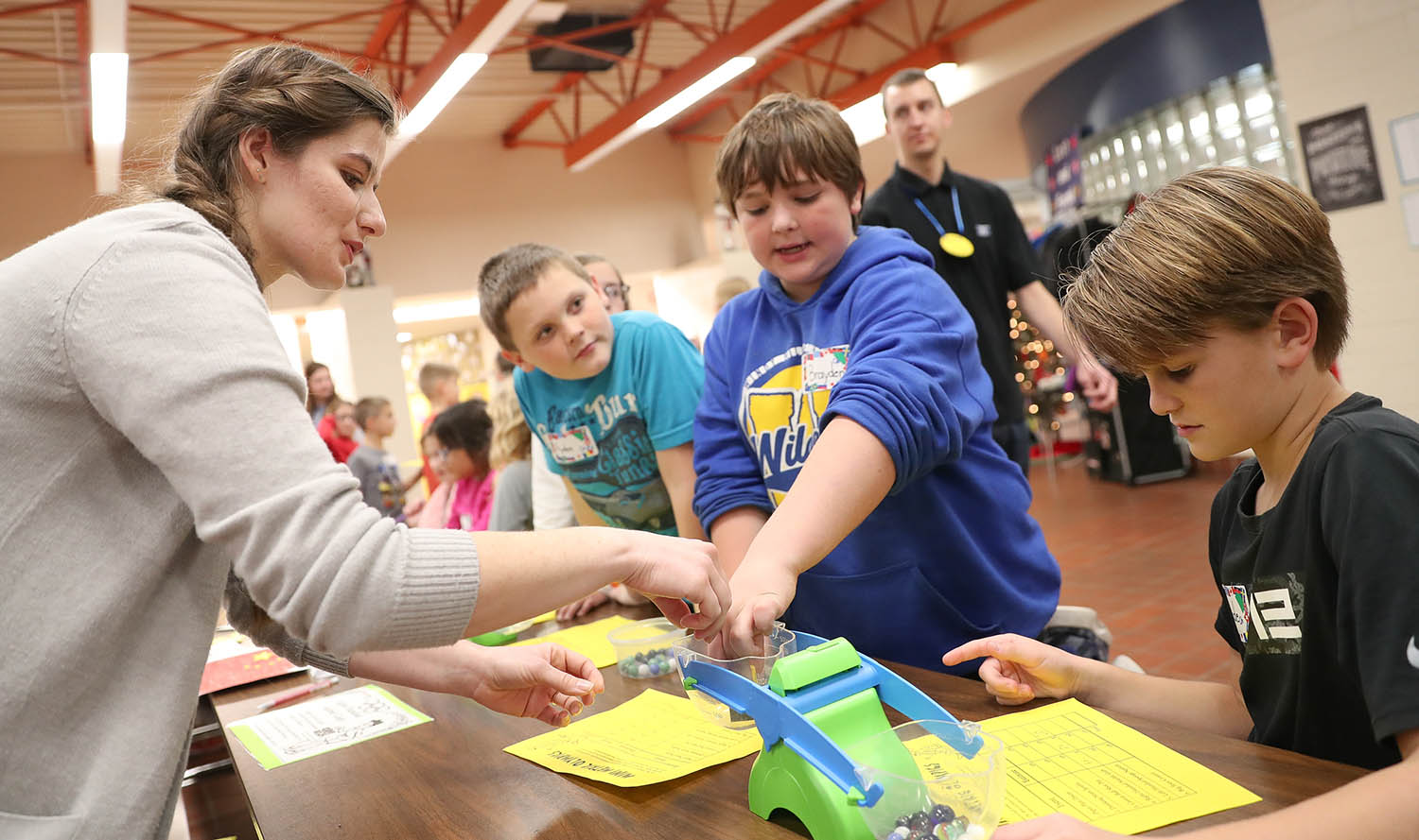 Shanna Laucomer, left, was one of more than 40 UNK students who led Friday's Measurement Olympics at Windy Hills Elementary School in Kearney.