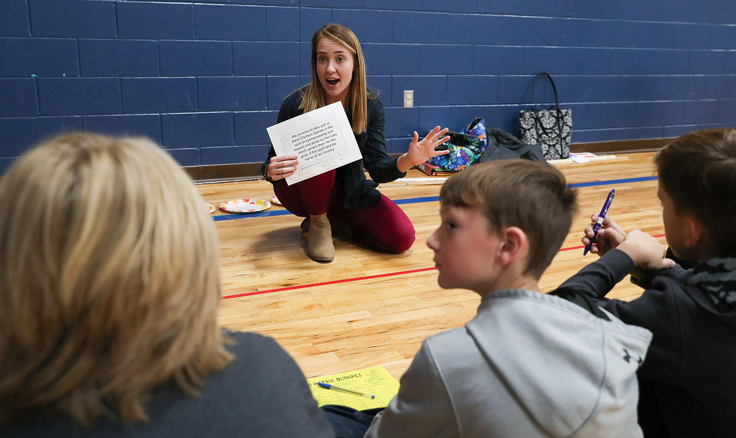 UNK student Mary Dworak of Omaha begins an activity Friday during the Measurement Olympics at Windy Hills Elementary School in Kearney.
