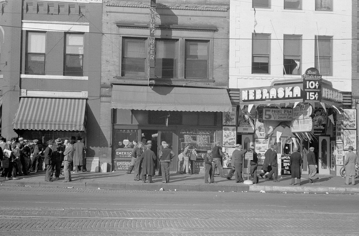 """Lower Douglas Street in downtown Omaha — """"one of the hobo centers of the West"""" — is pictured in this 1938 photograph by John Vachon. (Library of Congress)"""