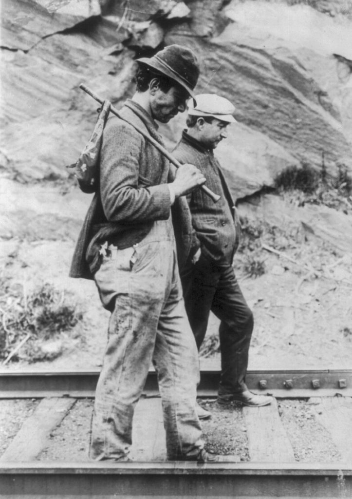 This photo by George Grantham Bain shows two hobos walking along the railroad tracks after they were removed from a train. (Library of Congress)