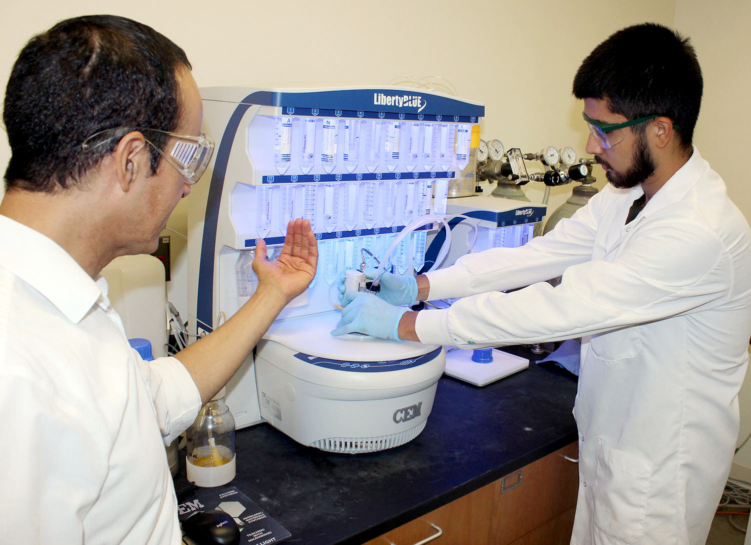 UNK chemistry professor Hector Palencia, left, works with Emerson Francisco Arias last summer during a faculty-led research project. Francisco Arias, a student at the Autonomous University of Nayarit in Mexico, spent seven weeks at UNK through the DELFIN research program. (Courtesy photos)