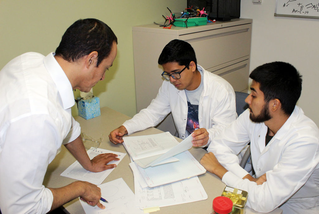 UNK chemistry professor Hector Palencia, left, hosted two students from Mexico last summer through the DELFIN research program. Emerson Francisco Arias, a student at the Autonomous University of Nayarit, right, and Omar Lozano Ramos, who attends the University of Colima, spent seven weeks at UNK while assisting Palencia with his research.