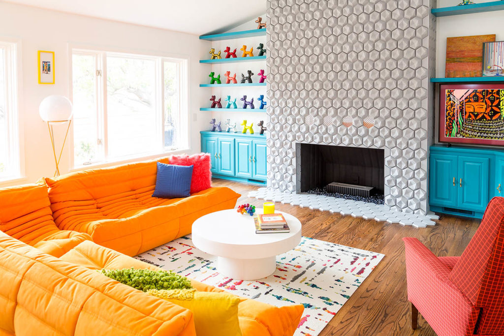 "Jenna Pilant's ""knack for bright colors"" is on full display in her home's family room. (656 Photography)"