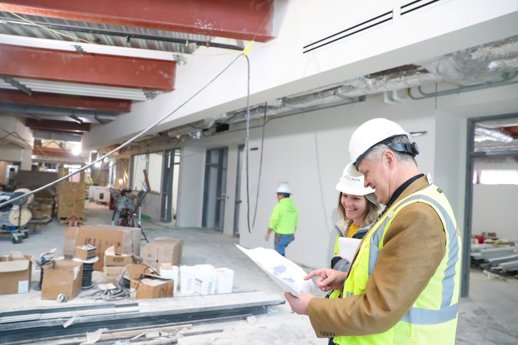 College of Business and Technology Dean Tim Jares and recruitment and communications specialist Erin Pearson look at layout plans for UNK's new STEM building during a recent tour of the 90,000-square-foot facility. (Photo by Corbey R. Dorsey, UNK Communications)