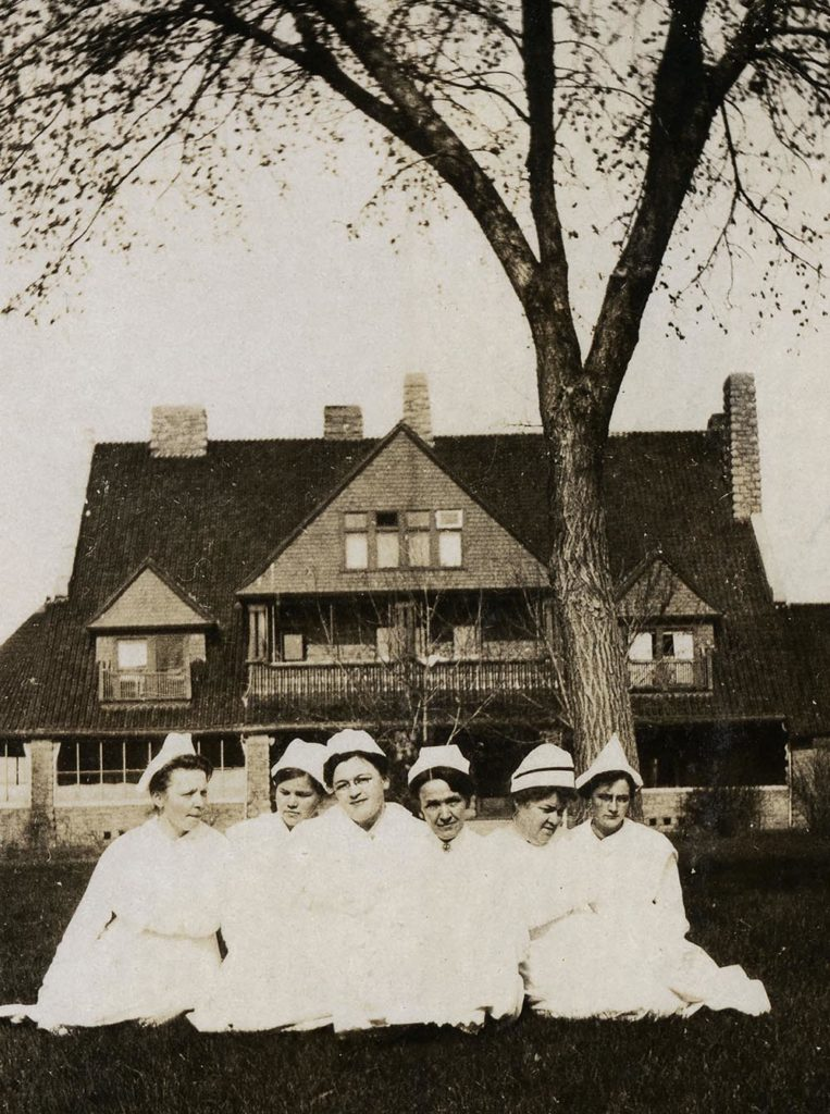 Nurses from the Nebraska State Hospital for Tuberculosis are pictured outside what is now the G.W. Frank Museum of History and Culture in Kearney. The hospital operated from 1912 to 1972 in buildings that are now part of UNK's west campus. (Courtesy photo)