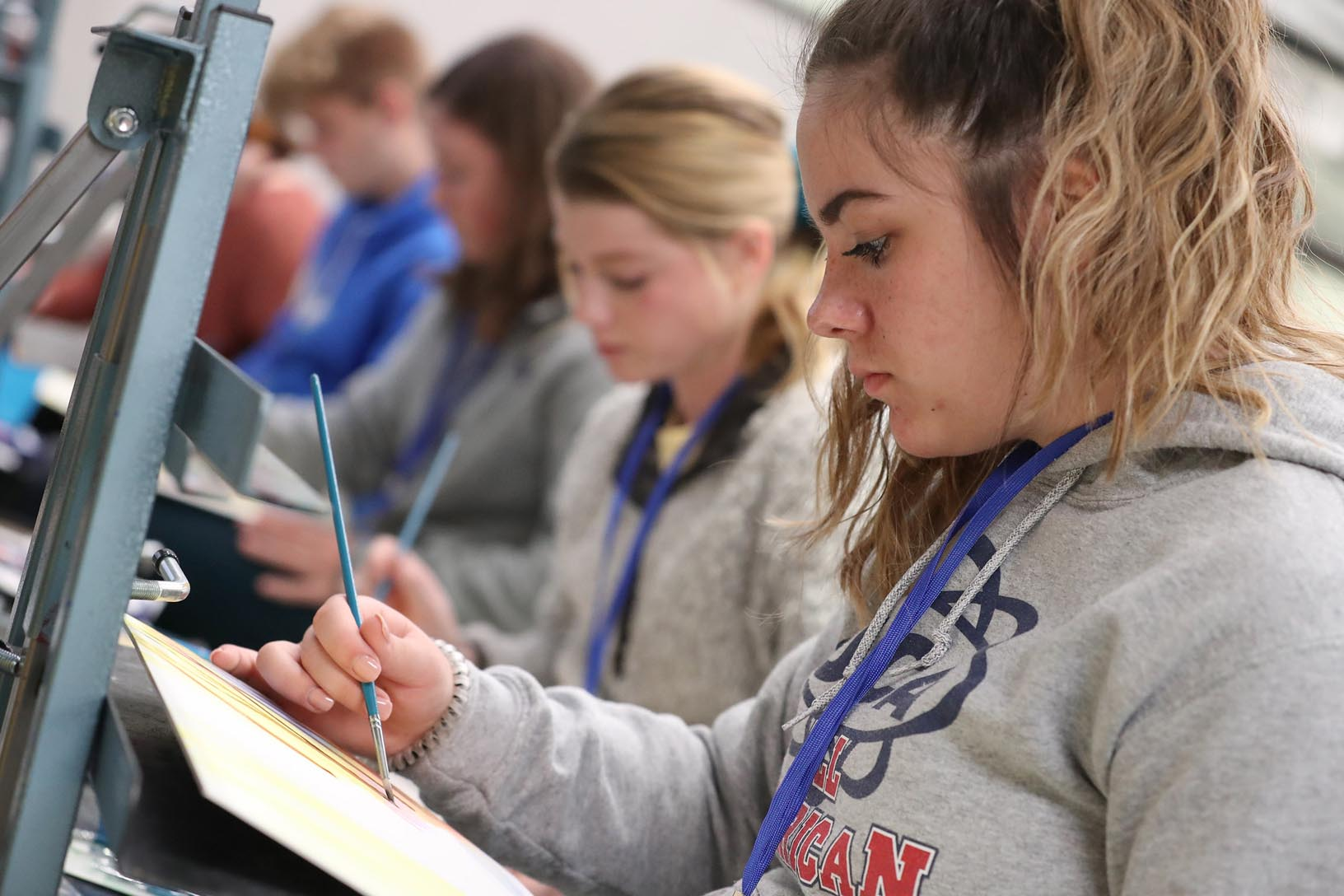 Gothenburg High School student Bailey Bryant works on a painting in the watercolor workshop during Imagination Day at UNK. More than 100 students from a dozen Nebraska high schools attended Wednesday's event hosted by UNK's Department of Art and Design. (Photos by Corbey R. Dorsey, UNK Communications)