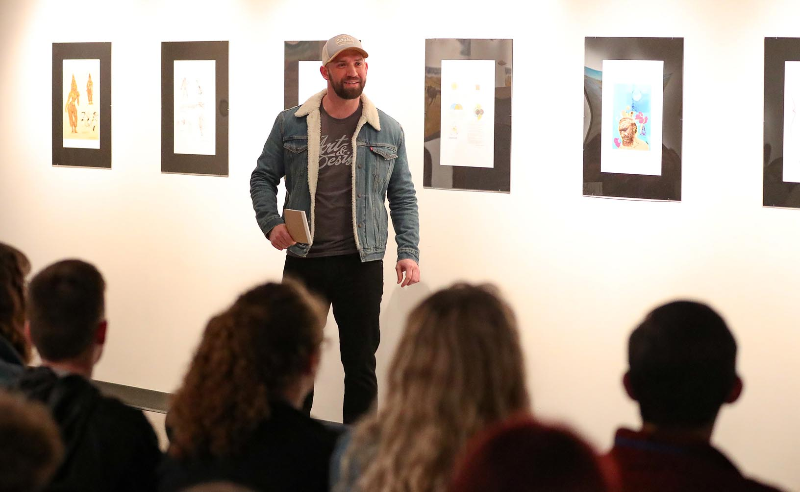 Kyle Sayler, owner of Sayler Screenprinting in Kearney, talks to high school students attending Wednesday's Imagination Day event at UNK. Sayler graduated from UNK in 2011 with a bachelor's degree in visual communication and design.