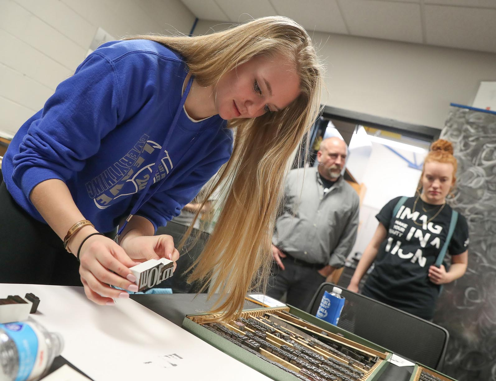 Faith Bierman, a student at Arnold Public Schools, participates in the letterpress printing workshop during Wednesday's Imagination Day event at UNK. Hosted by UNK's Department of Art and Design, Imagination Day gives high schoolers a chance to learn more about UNK programs and career options while exploring various art techniques in a hands-on environment.
