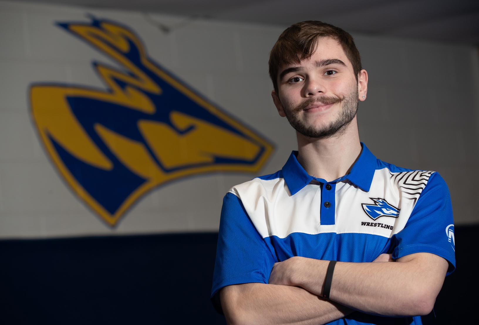 UNK wrestler Josh Portillo sets a high standard in both athletics and academics. He's currently ranked seventh in Division II at 125 pounds and he maintains a 3.98 GPA while studying health and physical education. (Photo by Corbey R. Dorsey, UNK Communications)
