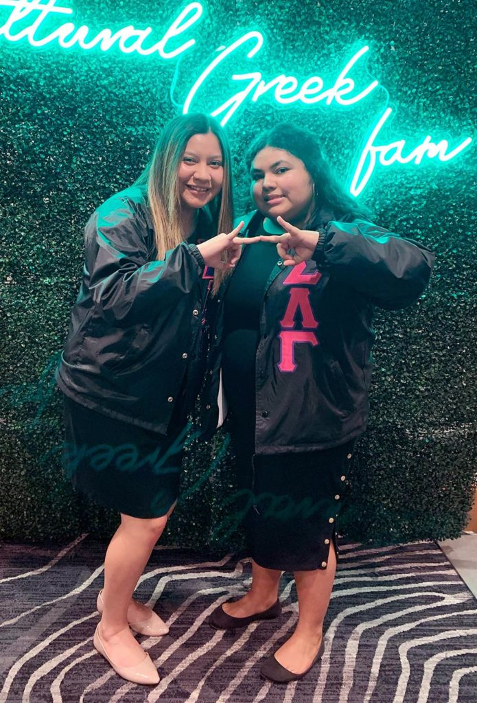 Sigma Lambda Gamma members Gracie Lopez, left, and Mariela Santos pose for a photo during the Association of Fraternal Leadership and Values conference in Indianapolis. Ten UNK sorority and fraternity members attended the event. (Courtesy photo)