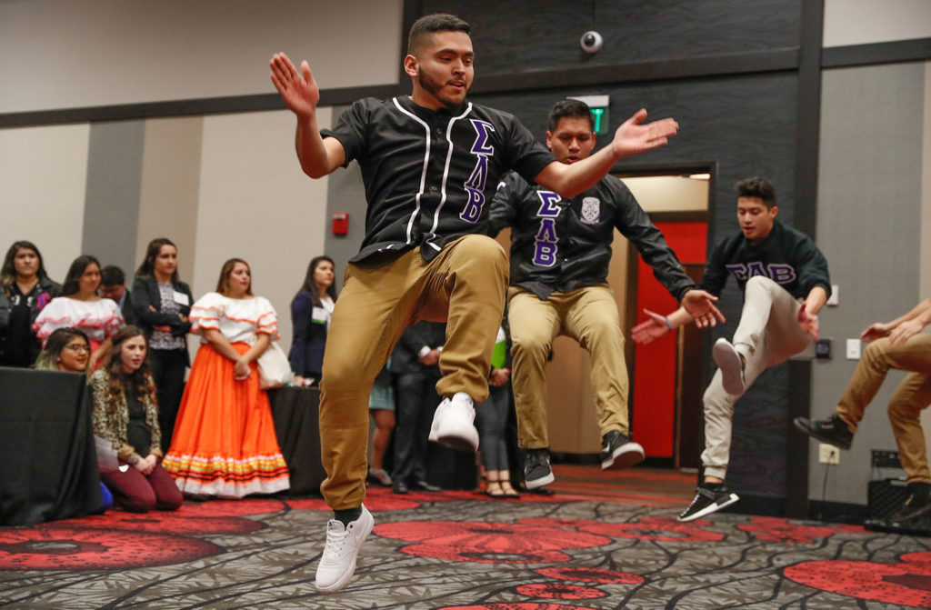 Members of UNK's Sigma Lambda Beta fraternity perform a stepping routine at the 2018 Nebraska Cultural Unity Conference. (Photo by Corbey R. Dorsey, UNK Communications)