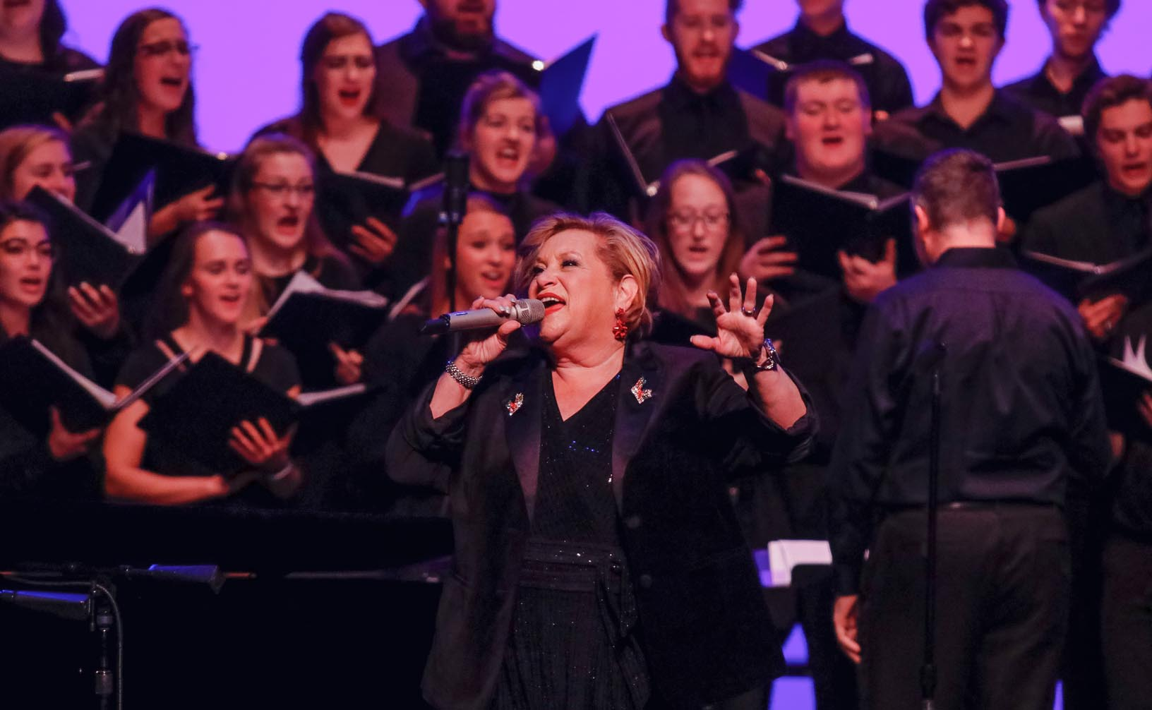 UNK's Choraleers perform with Sandi Patty during a December concert at the Merryman Performing Arts Center in Kearney. (Photo by Paul Pack, UNK Communications)