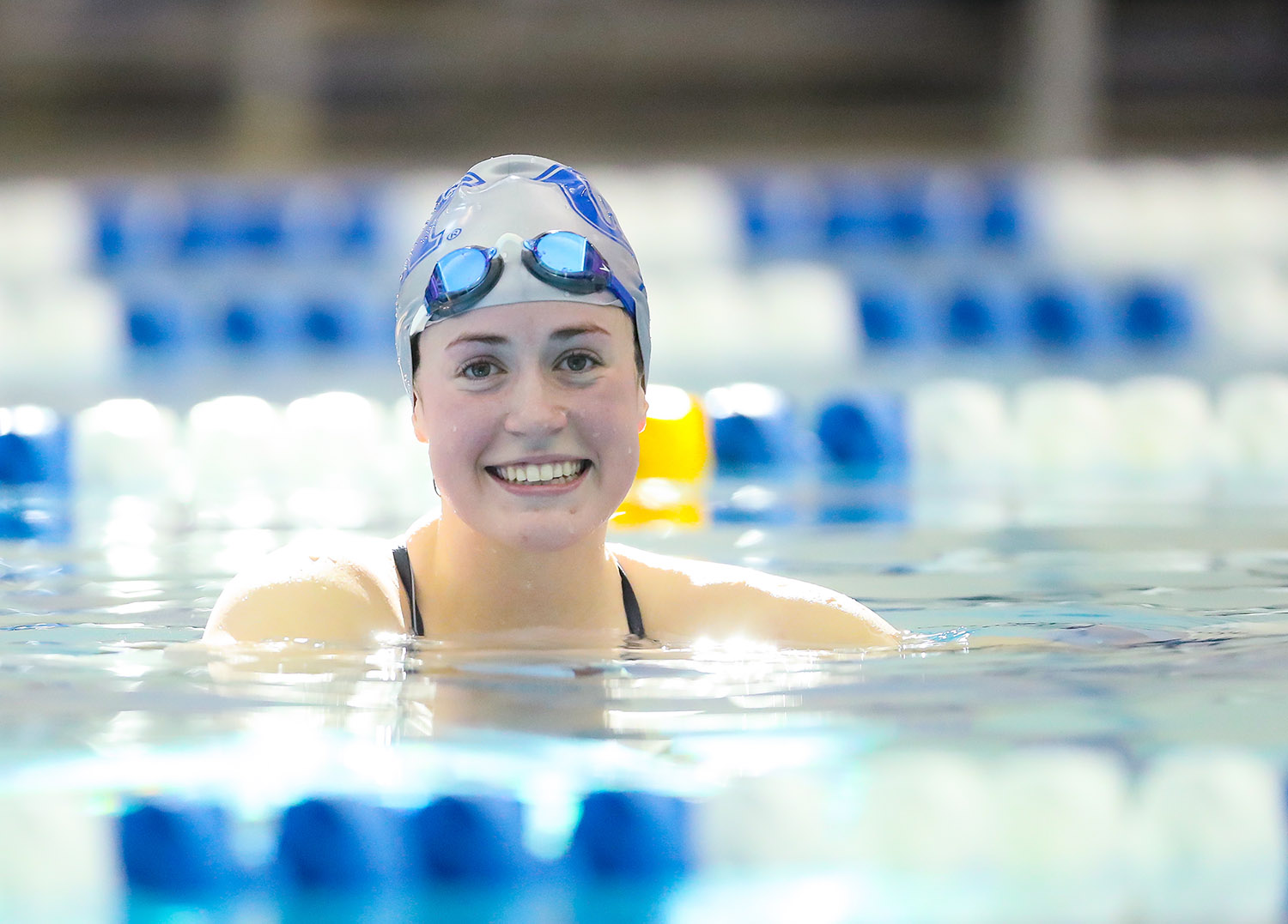 Mikara Feit, the lone senior on UNK's swimming and diving team, sets an example for her younger teammates with her work ethic and competitive spirit. The Lincoln Northeast graduate has competed in 15 different individual events this season and been part of five different relays. (Photos by Corbey R. Dorsey, UNK Communications)