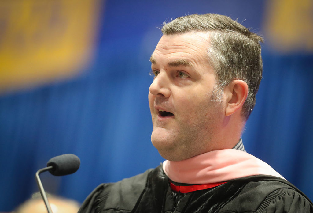 John Petzet sings the national anthem during UNK's winter commencement in December. (Photo by Corbey R. Dorsey, UNK Communications)