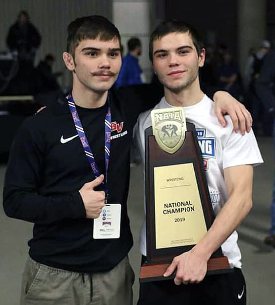 Twin brothers Josh and Justin Portillo are pictured at last year's NAIA national wrestling tournament, where Grand View University won its eighth straight team title. Justin wrestles for Grand View and Josh is a redshirt junior at UNK. (Courtesy photo)