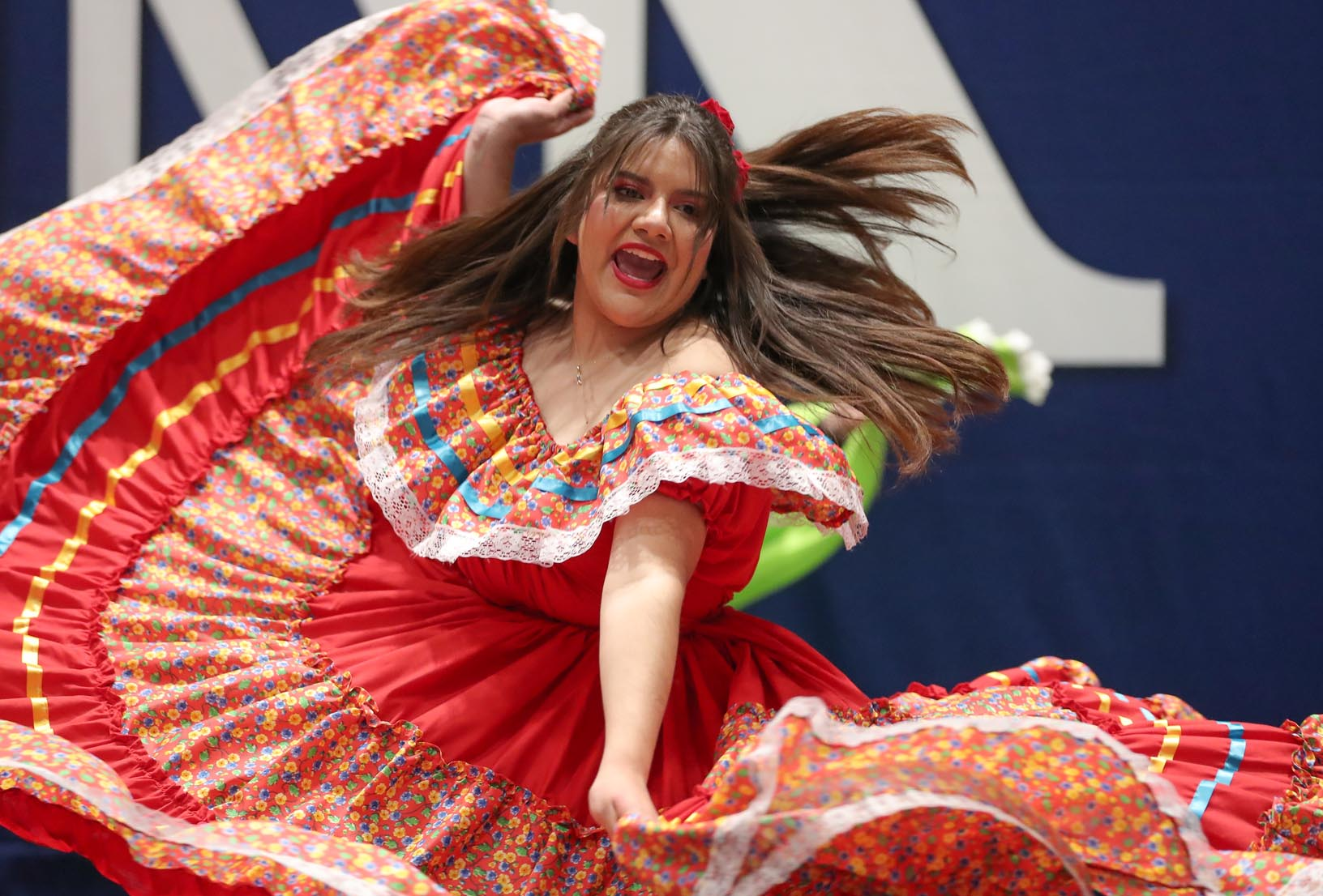A member of UNK's Danza student organization performs Sunday during the Scott D. Morris International Food and Cultural Festival at UNK's Health and Sports Center. Part of UNK's Office of Student Diversity and Inclusion, Danza consists of students from Latin American countries who perform traditional dances.