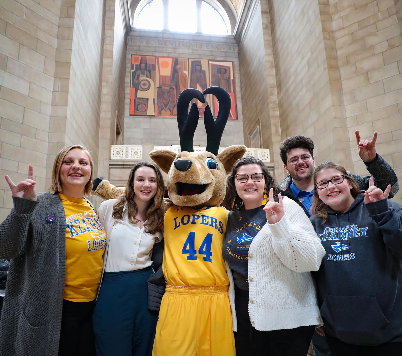 "UNK students pose with Louie the Loper inside the state Capitol building Tuesday during ""I Love NU Advocacy Day."""