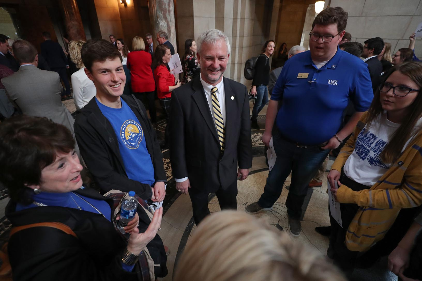 "State Sen. John Lowe of Kearney, center, meets with a group from UNK during Tuesday's ""I Love NU Advocacy Day"" event at the Capitol in Lincoln. (Photos by Corbey R. Dorsey, UNK Communications)"