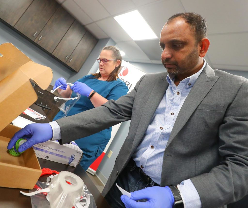 Shabri owner Rakesh Srivastava and employee Tammy Seamann assemble 3D-printed face masks and shields at the Hastings manufacturing facility.