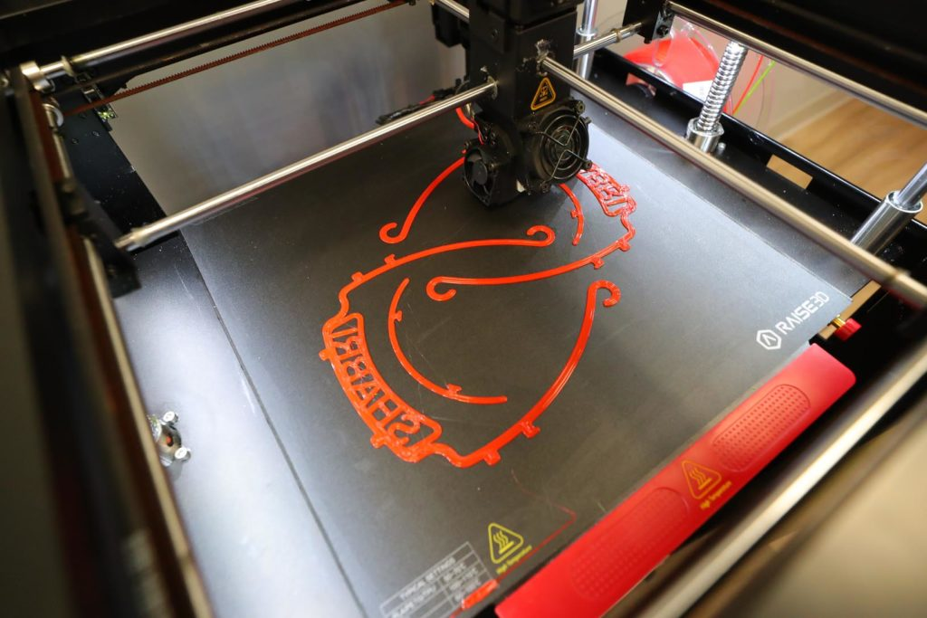 A 3D printer creates pieces for a face shield at Shabri in Hastings.