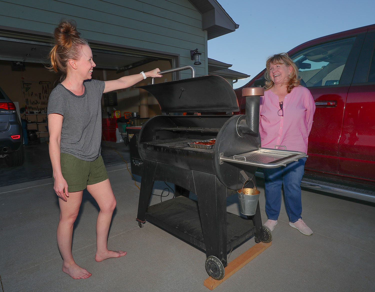 UNK family studies professor Tami Moore, right, chats with neighbor Jolene Jahn on Tuesday evening. Moore and UNK exercise science professor Greg Brown teamed up to start neighborhood celebrations in Kearney that allow people to interact while following social distancing guidelines.