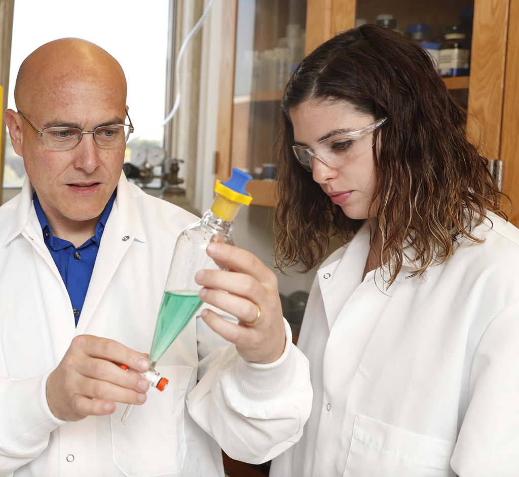 "UNK associate chemistry professor Allen Thomas and junior chemistry major Hannah Way have been working on research together since spring 2018. ""She's one of the hardest-working research students I've had,"" Thomas said. (Photo by Corbey R. Dorsey, UNK Communications)"