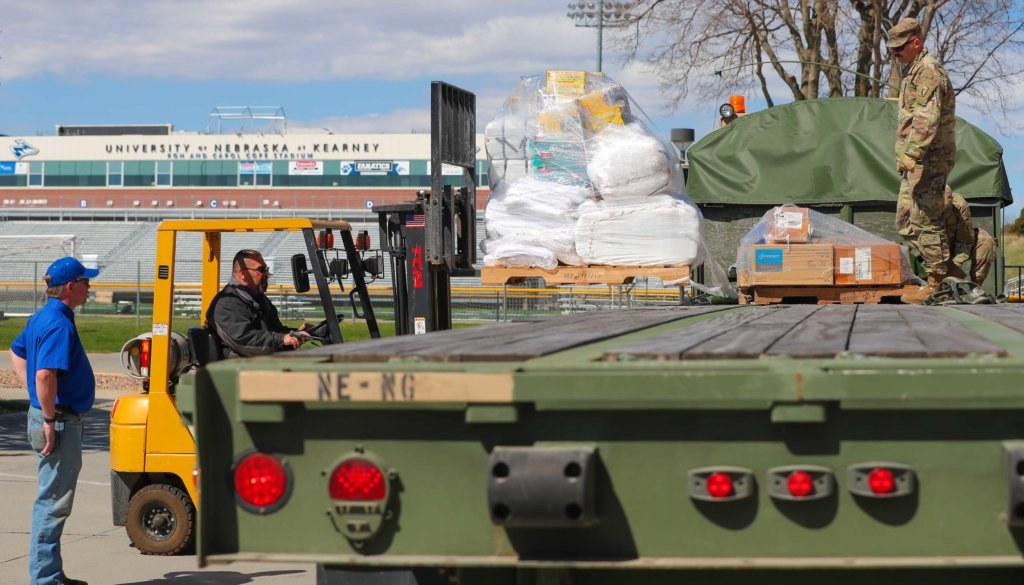 UNK facilities employees and members of the Nebraska National Guard load supplies into Centennial Towers West on April 21. On Wednesday, the state began housing individuals at UNK. (Photo by Corbey R. Dorsey, UNK Communications)