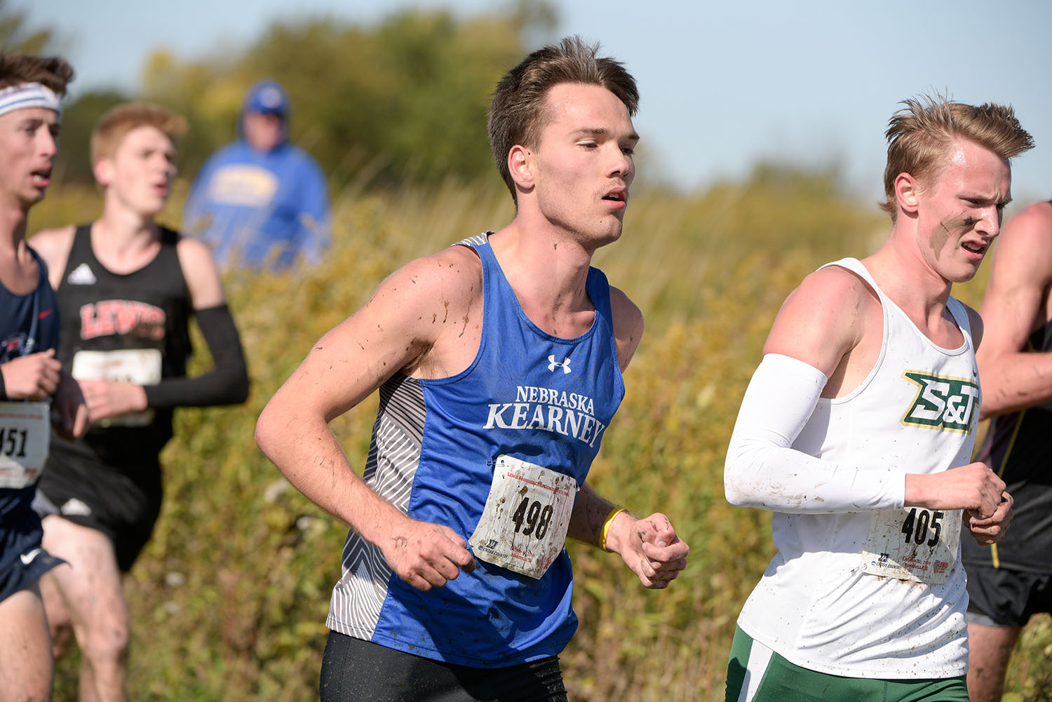 Nate Pierce, center, competed on the UNK cross country and track teams while maintaining a 3.6 GPA. (Steve Woltmann Photography)