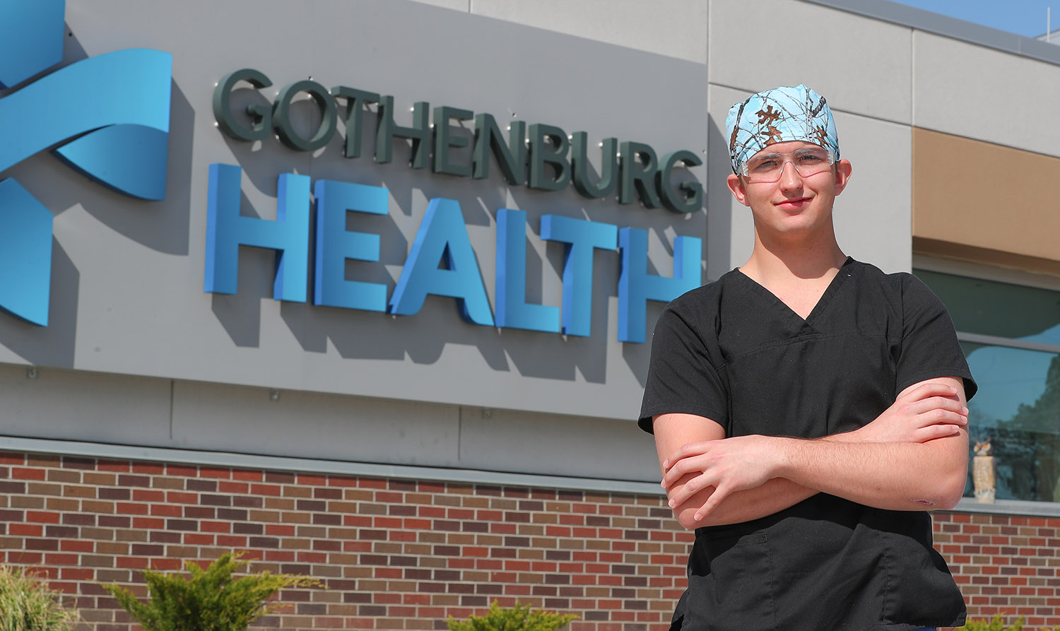 """UNK freshman Preston Smith works as a certified nursing assistant at Gothenburg Health. The 19-year-old says the coronavirus outbreak doesn't impact his decision to pursue a health care career. """"It's what we sign up for – to help people. We're there to help people during those hard times."""""""