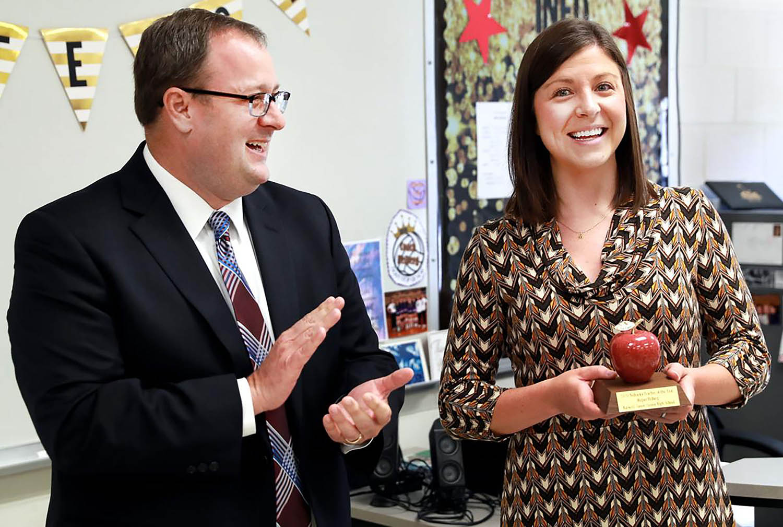 Nebraska Commissioner of Education Matt Blomstedt presents Megan Helberg with the Nebraska Teacher of the Year award during a surprise event in October. Helberg is an English teacher at Burwell Junior-Senior High School. (Courtesy photos)