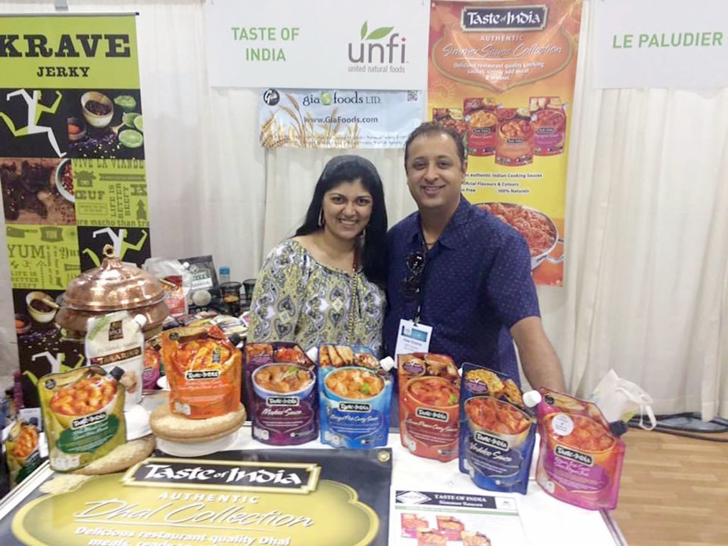 Tanya Wasson is pictured at an international food show last summer during her internship with Gia Foods. (Courtesy photo)