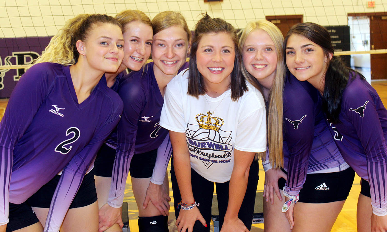 Megan Helberg, the head volleyball coach at Burwell High School, poses for a photo with the 2019 seniors.