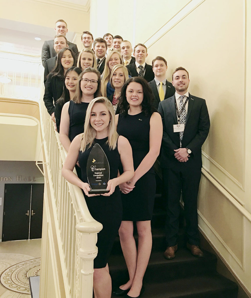 Grace Magill, front, poses for a photo with the UNK Enactus team after winning a regional competition in 2018.