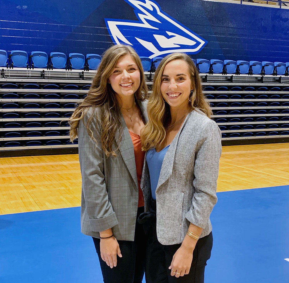 Graduate assistant athletic trainer Hailey McNee, left, and graduate assistant volleyball coach Kenzie Crawford pose for a photo inside the Health and Sports Center during their time at UNK. McNee spent two years working with student-athletes in the Loper volleyball and softball programs before earning her master's degree in May. (Courtesy photo)