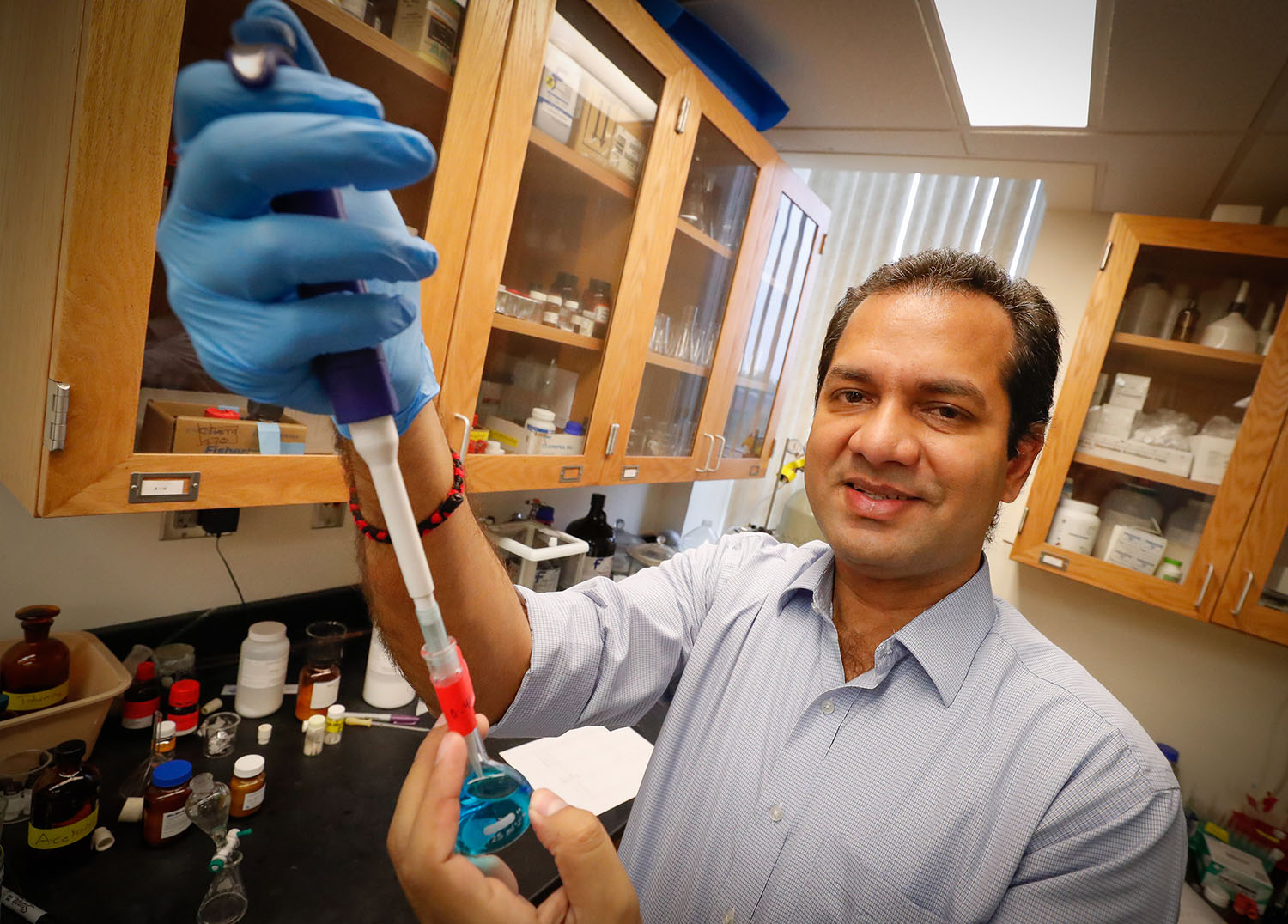 UNK associate chemistry professor Mahesh Pattabiraman is researching photoactive dyes that generate disinfecting molecules when they're exposed to light. The goal is to develop an effective and safe disinfectant for prosthetic limbs. (Photo by Corbey R. Dorsey, UNK Communications)