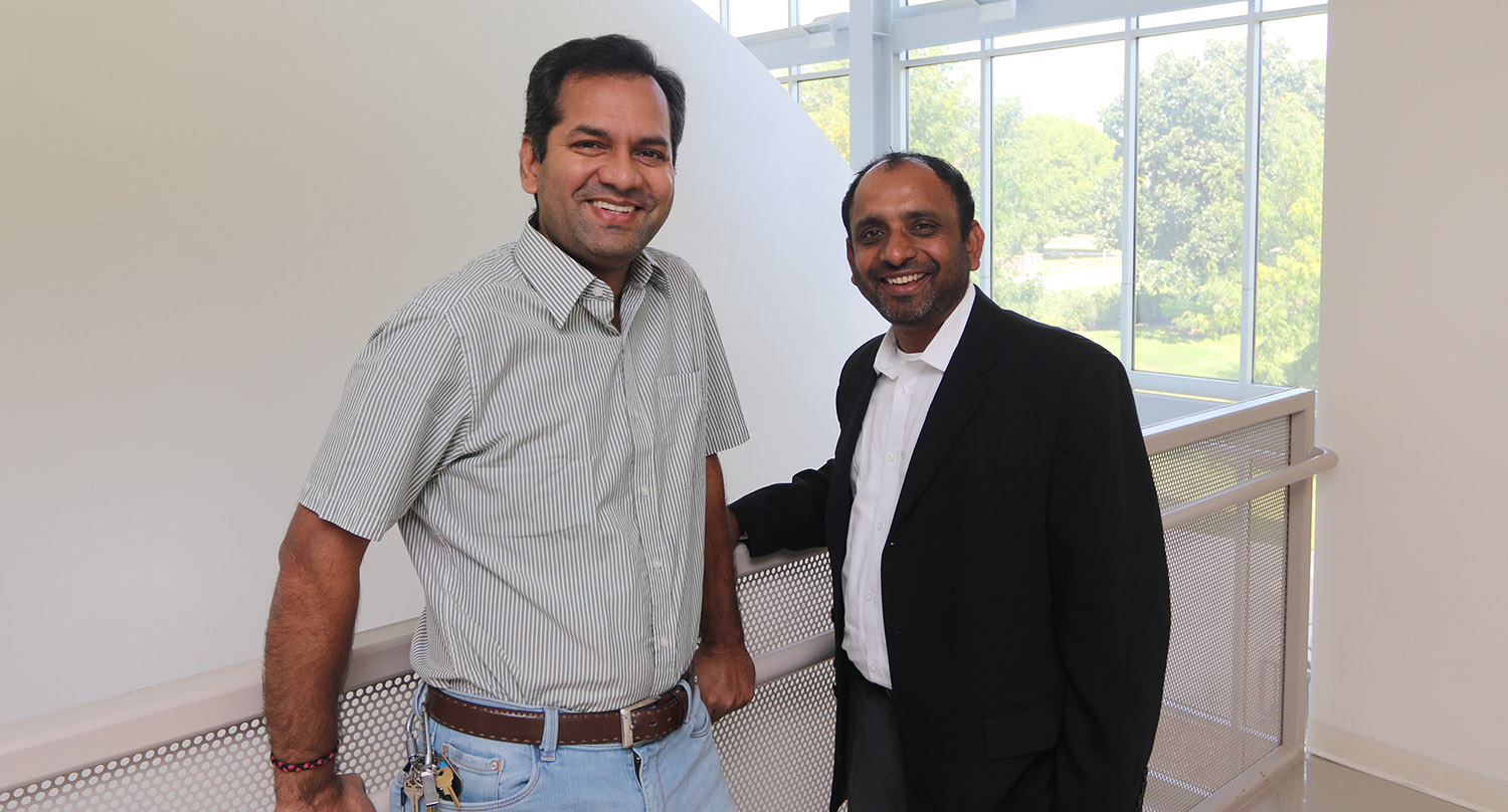 UNK associate chemistry professor Mahesh Pattabiraman, left, and UNK graduate Rakesh Srivastava are collaborating on a research project funded by the Nebraska Department of Economic Development. They hope to develop a light-activated disinfectant for prosthetic limbs. (Photo by Todd Gottula, UNK Communications)